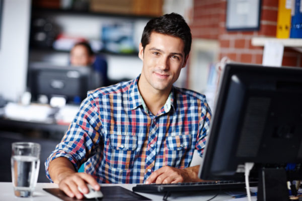 Young man at computer - IT Apprenticeship